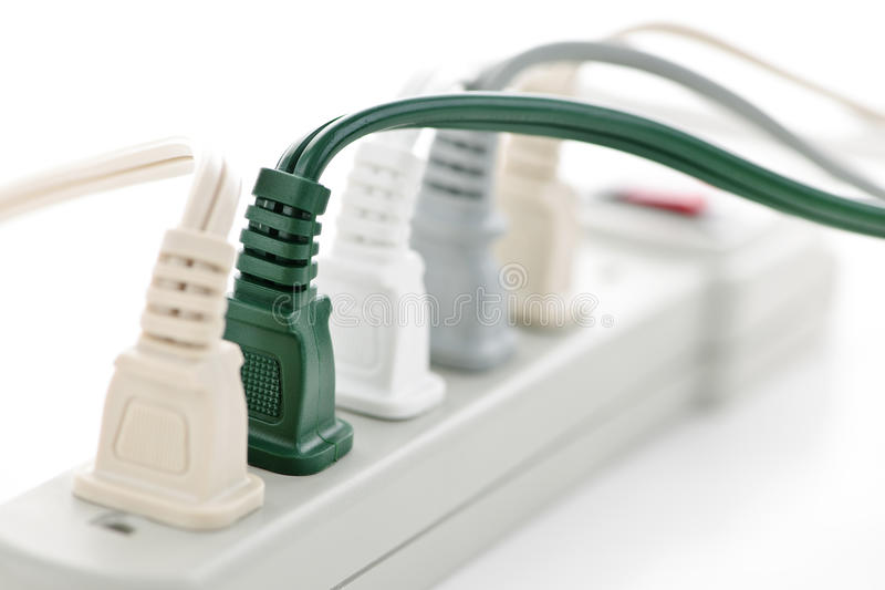 Wires plugged into power bar royalty free stock images