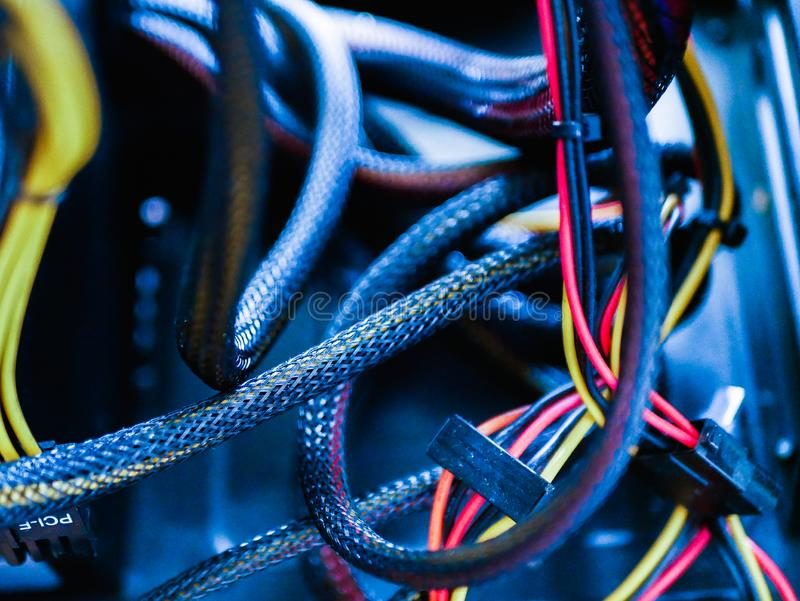Wires in the system unit of the computer. make-up wires from the power supply. Wires And Parts Inside A Computer System Unit stock image