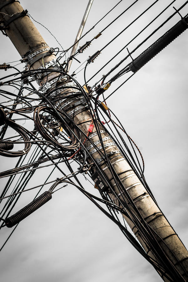 Wires on utility pole. A jumble of electrical and telephone wires attached to a utility pole in Ribeirao Preto, Sao Paulo - Brazil. Copy space available royalty free stock photography