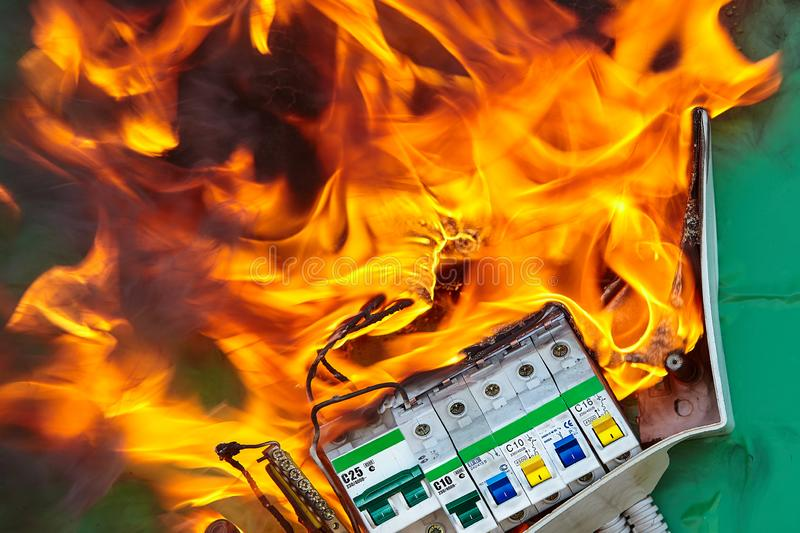 Wiring systems in electrical panel caused a fire. Fire can occur when there are instances of faulty electrical appliances and wiring at home, causing an royalty free stock photo