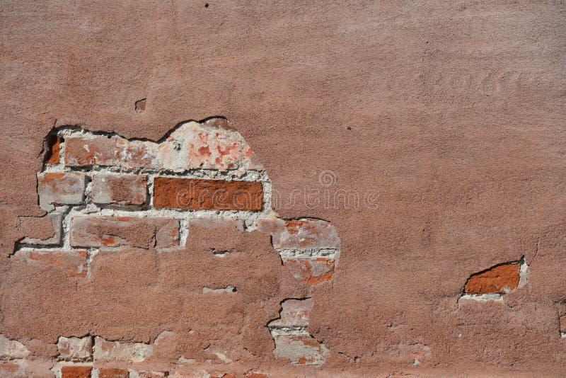 Wirkliche geschädigte Hintergrundbeschaffenheit Schmutz-rote Stonewalls lizenzfreies stockbild