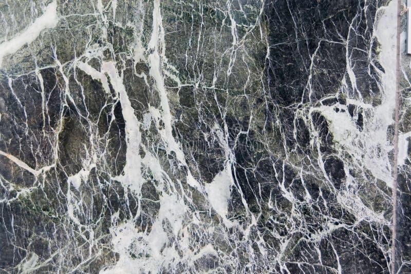 Wirklicher dunkler Marmor mit Lasten von Beschaffenheiten lizenzfreie stockbilder