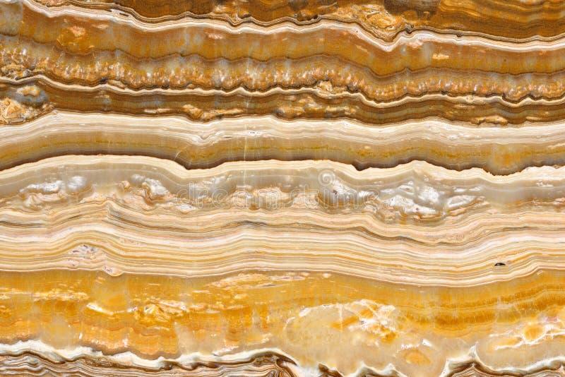 Wirkliches natürliches Muster des ONYX Onice-Reich-Goldbeschaffenheitshintergrundes stockfotografie