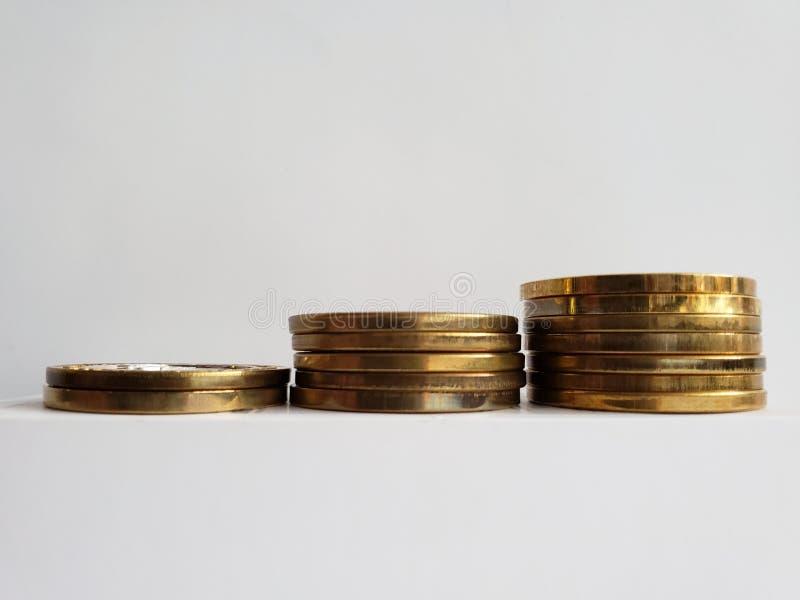 Wirtschaftswachstum, Staplungsgoldmünzen, Hintergrund und Beschaffenheit stockfotografie