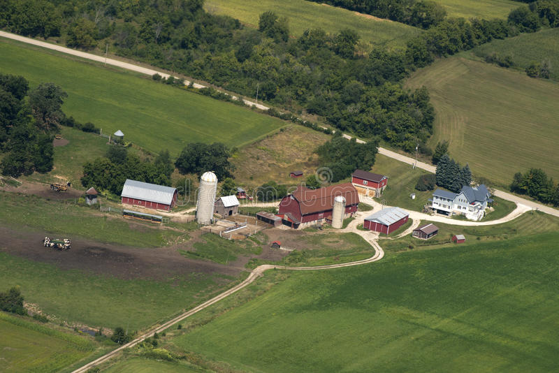 Wisconsin Dairy Farm and Barn Aeiral View. Aerial view of a Wisconsin dairy farm. You can see a barn, farmhouse, and cows in the pasture royalty free stock photos