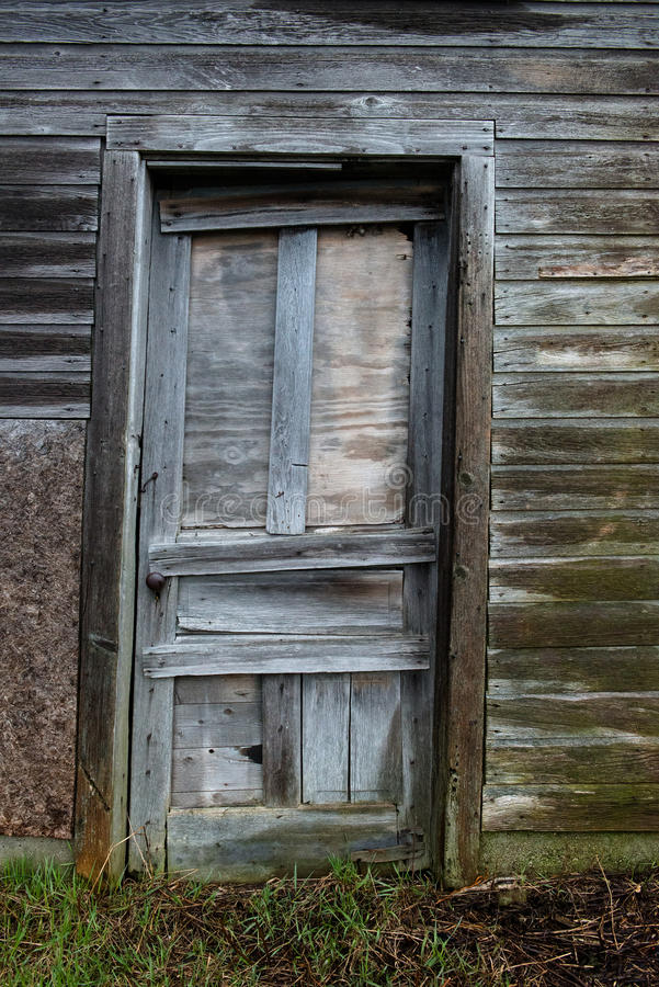 Wisconsin Dairy Farm Farmhouse Door. Detail image of a door on an old Wisconsin dairy farm. The farmhouse is an old, vintage building and home stock images
