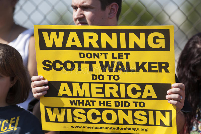 Wisconsin Governor Scott Walker Presidential Announcement Protest. WAUKESHA, WI/USA - July 13, 2015: A man holds a protest sign in front of the Waukesha stock image