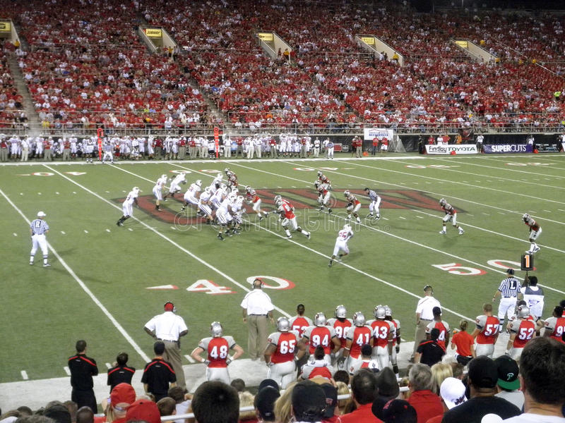 Wisconsin offense in action against UNLV. Wisconsin vs. UNLV: Wisconsin offense in action against UNLV. Taken September 4 2010 at Sam Boyd Stadium Las Vegas royalty free stock image