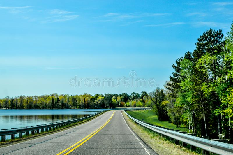 Wisconsin Roadscape with Lake and Forest royalty free stock image