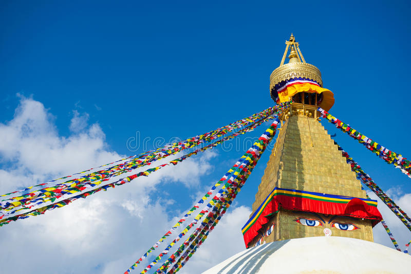 The Wisdom eyes on Boudhanath stupa landmark of Nepal. The Wisdom eyes on Boudhanath stupa landmark of Kathmandu , Nepal royalty free stock images