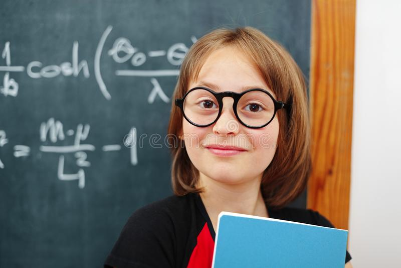Wise math schoolgirl royalty free stock image