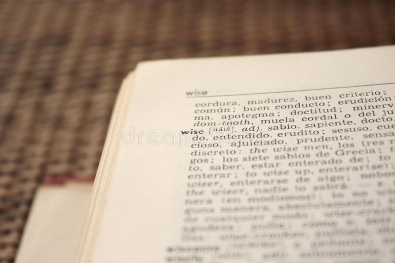 'wise' word in English-Spanish dictionary royalty free stock photography