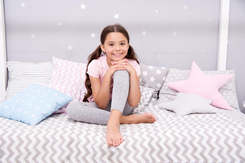 Wish her sweet dreams. Girl child sit on bed her bedroom. Kid prepare go to bed. Pleasant time relax cozy bedroom. Girl royalty free stock photography