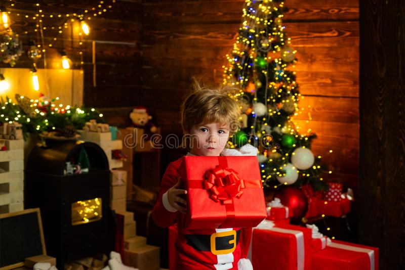 Wish list. Childhood memories. Boy cute child cheerful mood christmas gift. Family holiday. Merry and bright christmas royalty free stock images