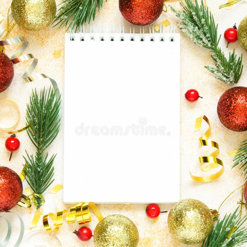 Wish list for New Year. Holiday decorations and notebook. Planning concept. Copy space. Top view. royalty free stock image