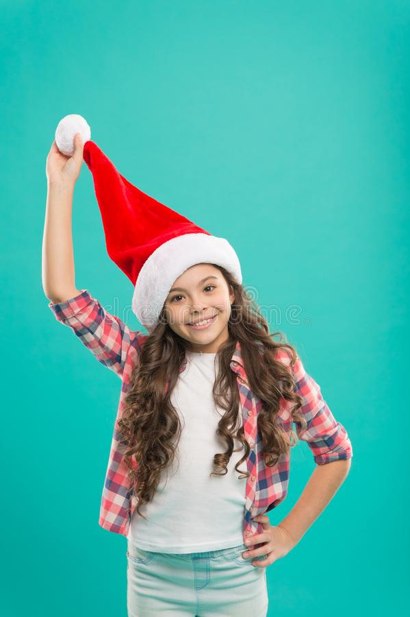 Wish to grow faster. Santa claus kid. Happy winter holidays. Small girl. Waiting for Santa. Spread joy and love, it is royalty free stock photography