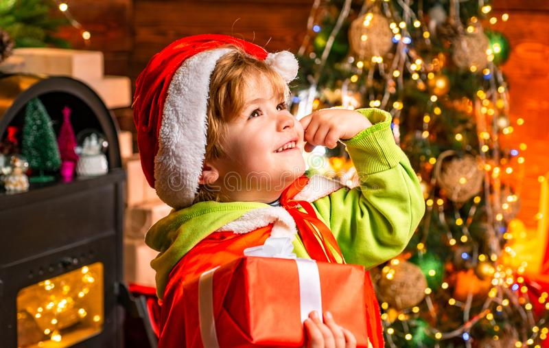 Wish to meet santa claus. Merry christmas and happy new year. Happy childhood. Adorable child play at home. Dreamy baby. Toddler on christmas eve. Believe in royalty free stock image