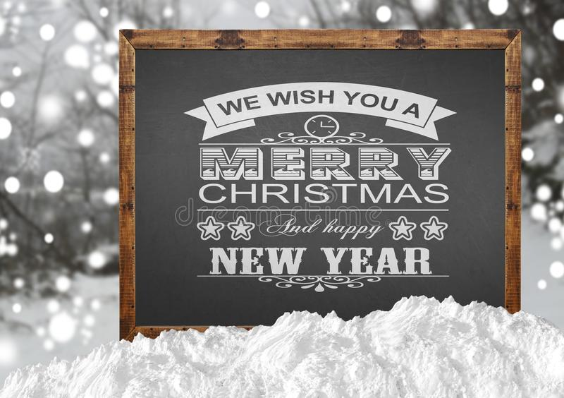 We Wish You A Merry Christmas and Happy New Year on blackboard royalty free stock photos