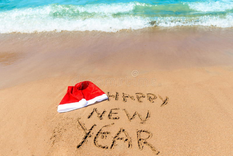 Wishes a happy new year. On the beach royalty free stock photography
