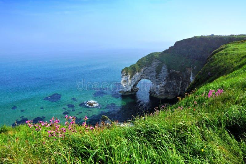 Wishing Arch of white rock, Causeway Coast, Northern Ireland. Wishing Arch along coastline of white cliffs, Causeway Coast, Northern Ireland stock photos