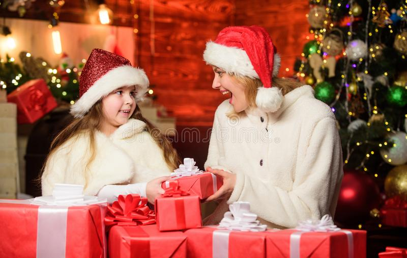 Wishing a happy New Year. small child girl with mom in santa hat. merry christmas. mother and daughter love holidays stock photo