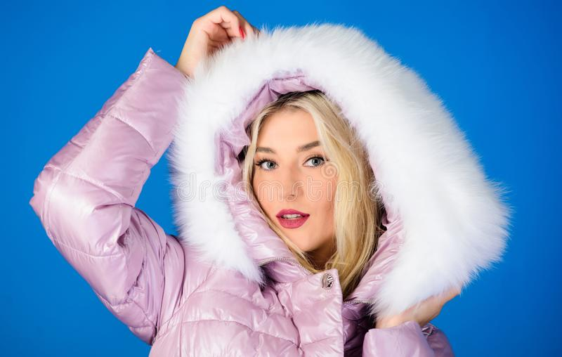 For those wishing stay modern. Fashion environmental awareness. Faux fur is more than just trend. Winter clothes. Down. Jacket with furry hood. Girl wear winter royalty free stock photos