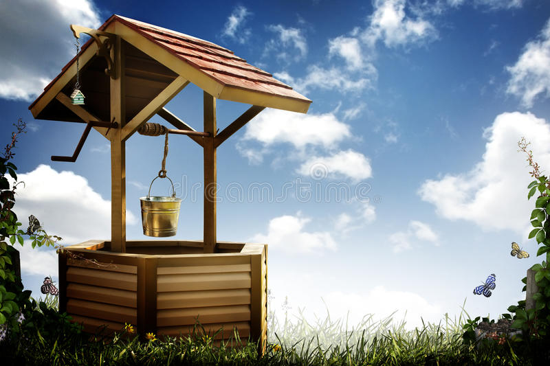 Wishing well. A wooden magic wishing well with bucket in a grassy area with vines, butterflies and a cloudy summer sky