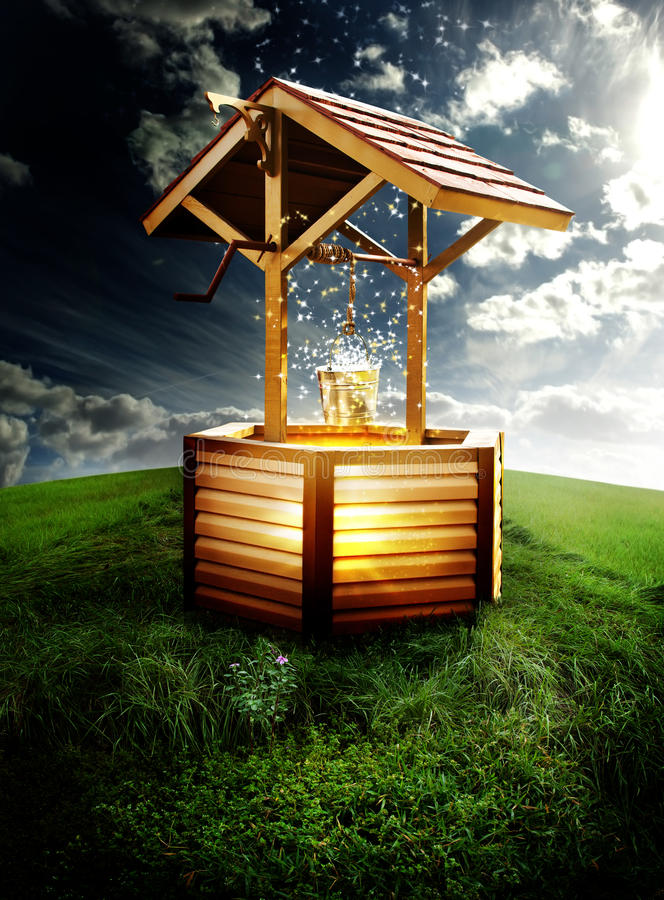 Wishing well. A wishing well with stars and bright light coming from well on a grassy meadow. Concept for wishes or dreams to come true