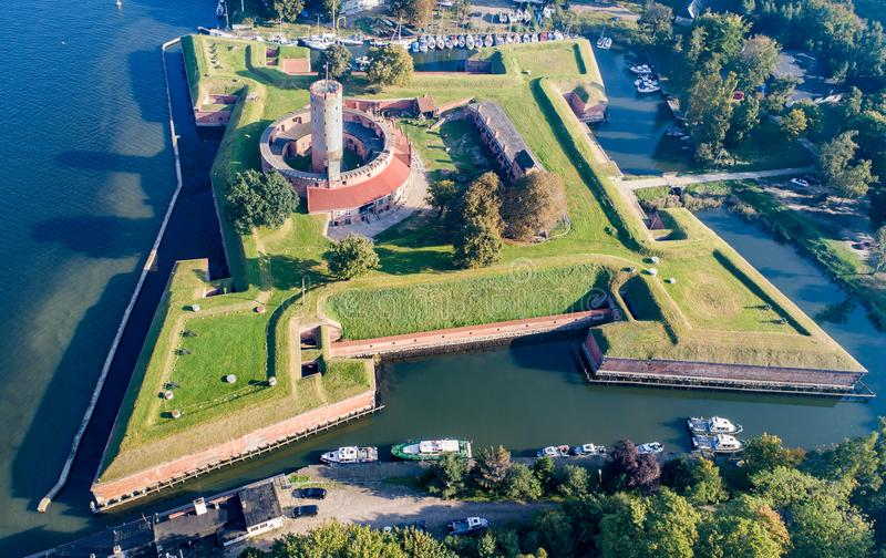 Wisloujscie Fortress in Gdansk, Poland. Aerial view. Medieval Wisloujscie Fortress with old lighthouse tower in port of Gdansk, Poland A unique monument of the stock image