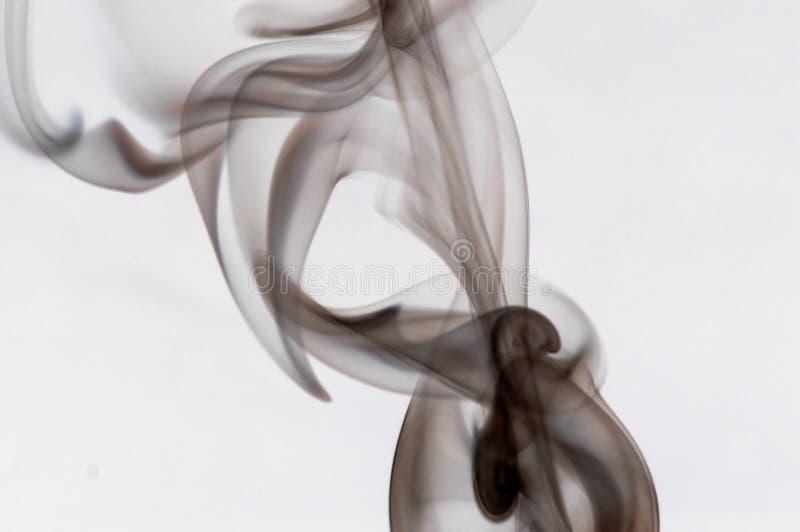 Wisp of Smoke. A wisp of colorful smoke stock photos
