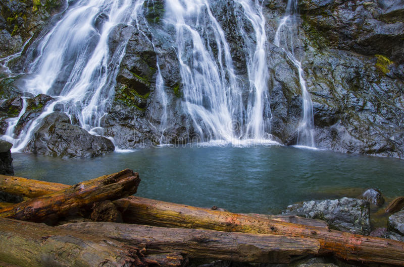 Wispy Rocky Brook waterfall in Olympic National Forest. Rocky Brook falls in the Dosewallups river valley in Olympic National Forest stock photography