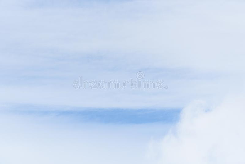 Wispy white clouds against a blue sky as a nature background stock illustration