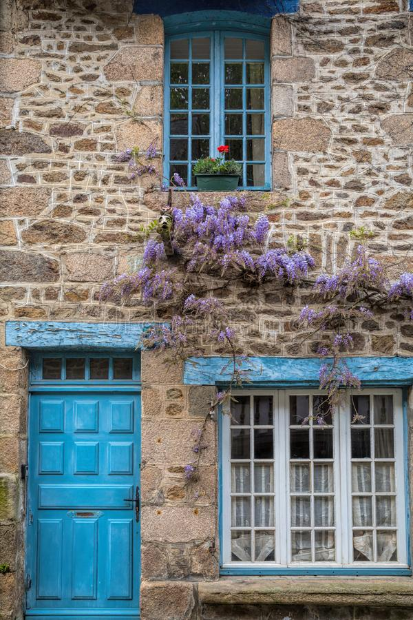 Wisteria on a cottage wall in rural France stock photo
