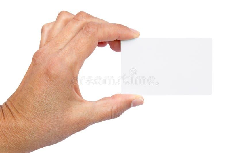 Wit adreskaartje in de hand van een vrouw stock afbeelding
