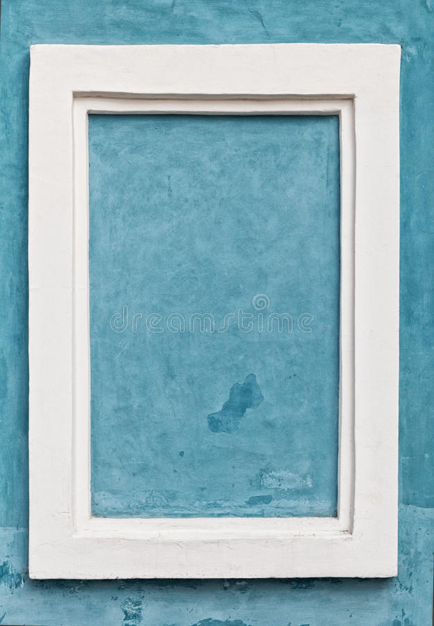 Wit frame op blauwe muur royalty-vrije stock foto