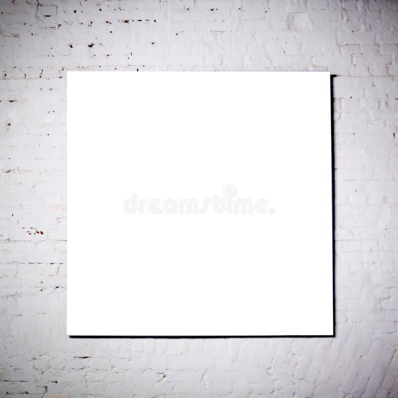 Wit frame op witte bakstenen muur stock foto
