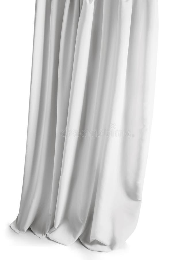 Wit grijs die gordijn op een witte achtergrond wordt geïsoleerd stock foto's