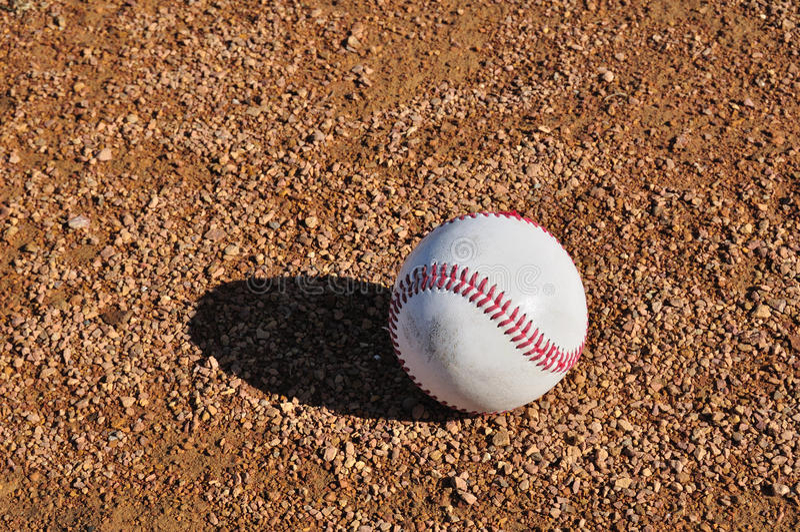 Wit Honkbal op Infield stock foto's