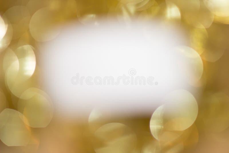 Wit op gouden fonkelingen stock afbeelding