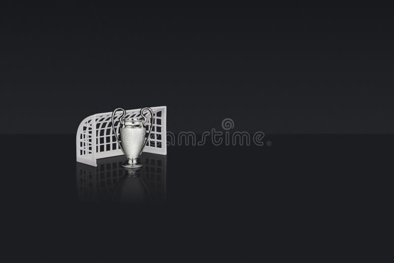 Wit plastic de voetbaldoel & Mini Replica Champions van de lijstbovenkant stock foto