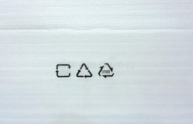 Wit Schuimdocument voor verpakkingstextuur met kringloopsymbool royalty-vrije stock fotografie
