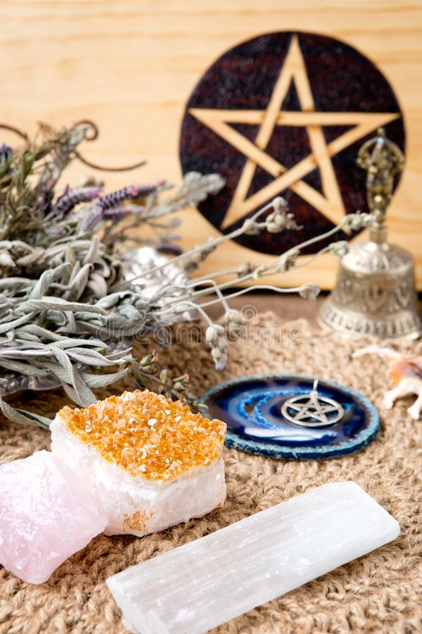 Free Witch Altar Decorations - With Pentacle, Herbs And Crystals, With Natural Crotchet Jute Altar Cloth Royalty Free Stock Photography - 131543357