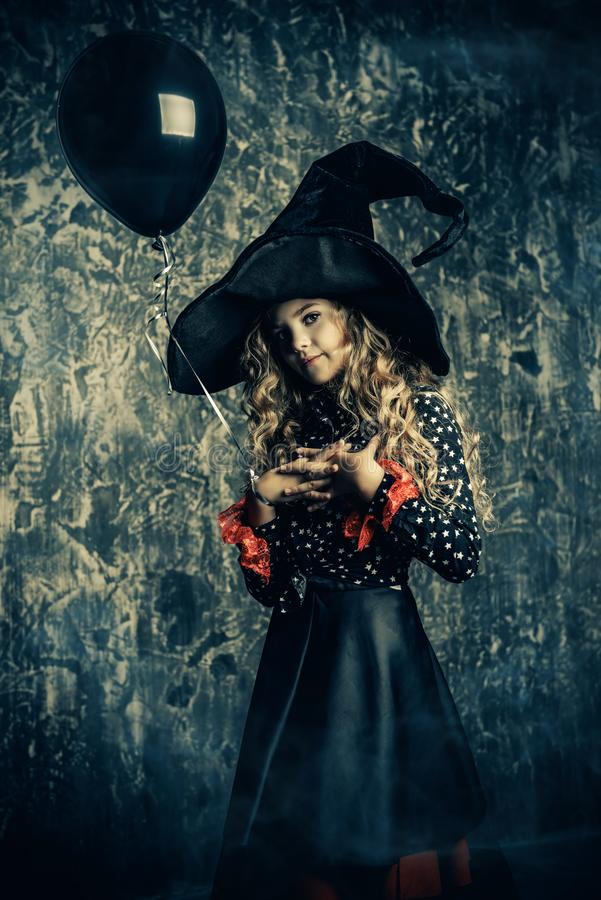 Witch with black balloon stock photography