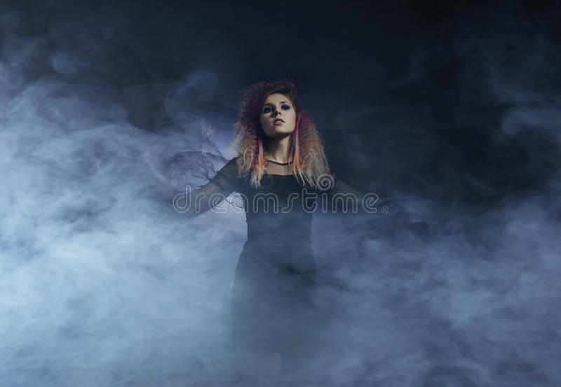 Witch in a blowing textile on a Halloween background.  royalty free stock photos