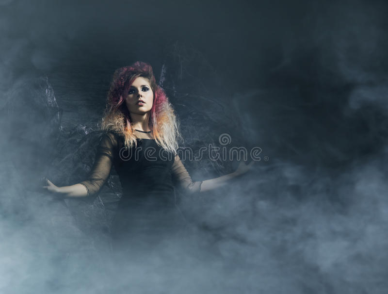 Witch in a blowing textile over the Halloween background.  stock photos