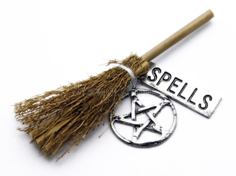 Witch Broom, Pentacle, Spells. A magical witches broom, pentacle talisman, and silver banner printed with spells royalty free stock image