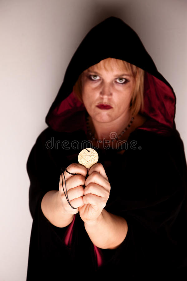 Witch in a corner with talisman royalty free stock images
