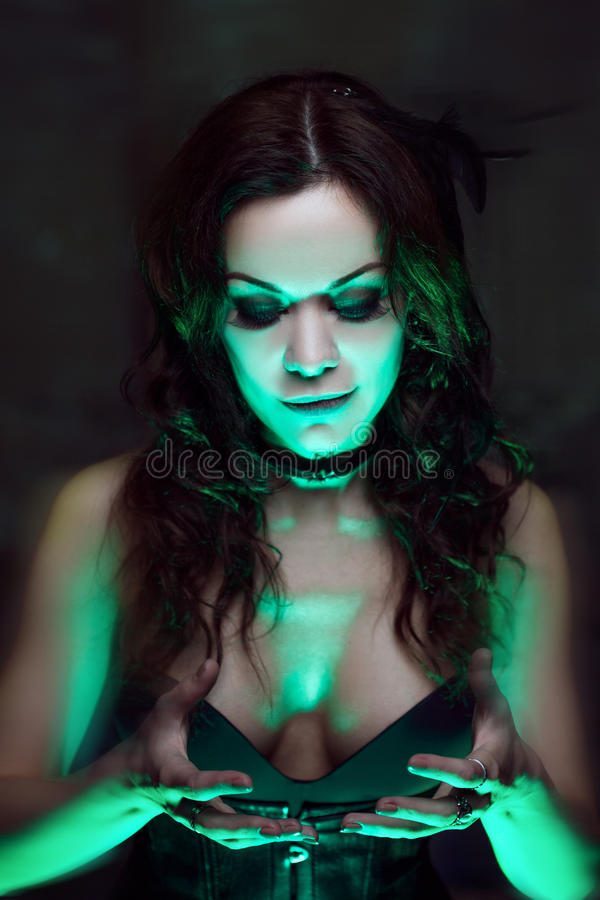 Free Witch Creates Magic. Beautiful And Woman With A Mystical Light Royalty Free Stock Photos - 77410078