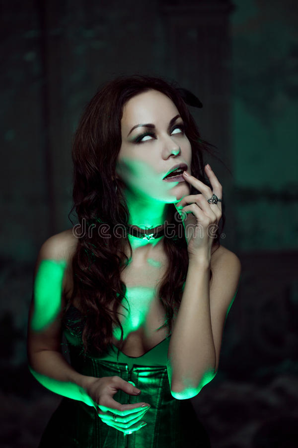 Free Witch Creates Magic. Beautiful And Woman With A Mystical Light Royalty Free Stock Image - 77410146