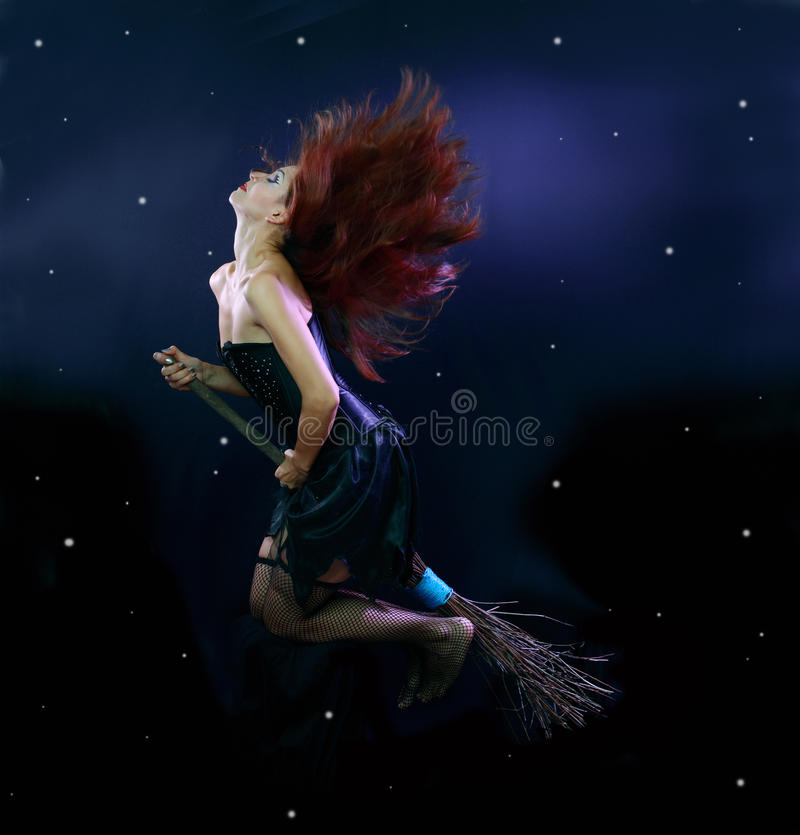 Witch flying on broom stock photos